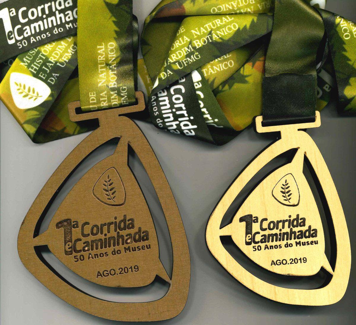 Medalhão de campeão na fx etária M5059 e medalha de participação(frentes)